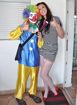This clown is not scary at all, but he gives it to Lara hard