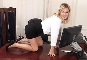 Office MILF Katherine Jackson butt naked on her desk.