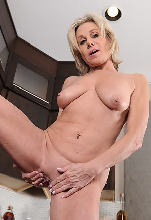53 year old Payton Hall spreads her mature pussy in the kitchen