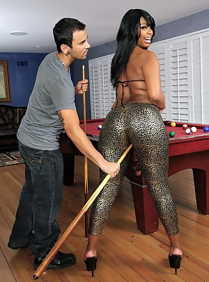 Strong man is teaching this kinky chocolate lady how to play billiards. He is also penetrating her sweet pussy and gentle mouth with his cock.
