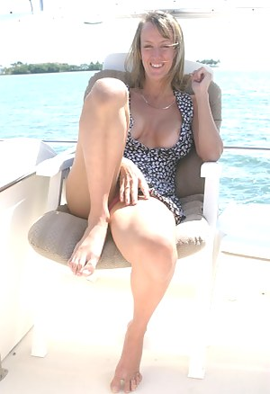 Tanned blonde has her wet cunt fucked in doggy style after she makes her captain's cock hard with a first class blowjob on his yacht.