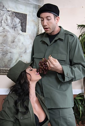 Fucking this gorgeous brunette is what the strong army man is fond of. She is holding the gun while taking care of his massive boner.