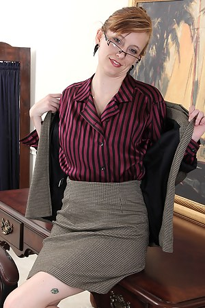Office MILF Alex from AllOver30 strokes her naturally hairy bush here