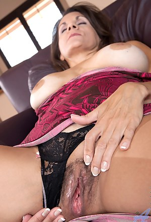 Classy Anilos lady pleasures her mature pussy with a purple vibrator
