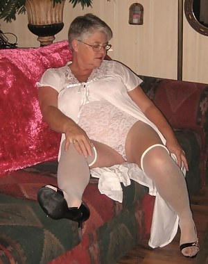 Relaxing in my sexy all in one body shaper, white stockings and heels, I'm always ready to cock tease and seduce you. My