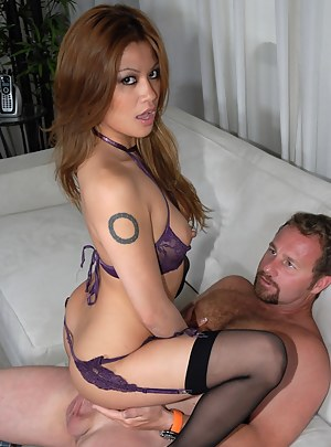 Strong man is satisfying this lovely Asian slut wearing sexy purple stockings. She is riding and sucking his white cock making you love this interracial porn.