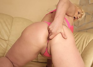 Horny mature slut masturbating and playing