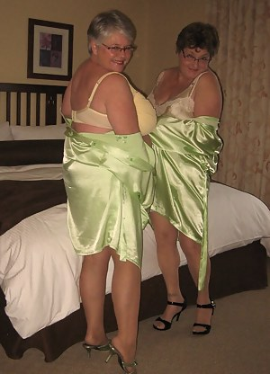 Those two sexy sirens are at it again, wearing their hot sexy girdles and lingerie.