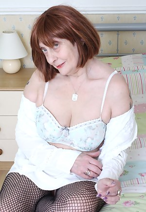 Naughty British mature lady getting wet on her bed