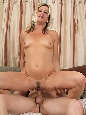 44 year old blond Trinket gobbles and fucks younger cock in here