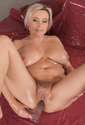 44 year old Sindy Huga plants a large red dildo into her mature box
