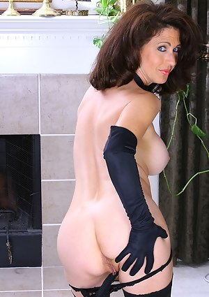 Sexy mature Madison slips off robe and wows us with her body