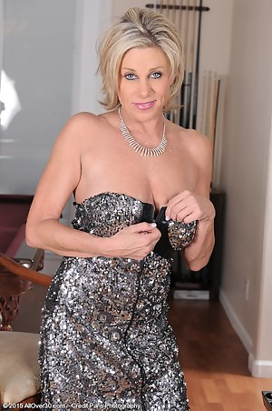 53 year old Payton Hall slips out of her elegant dress just for you