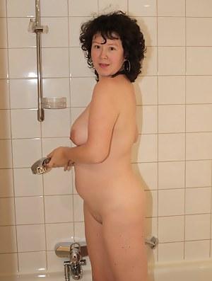 Horny mature slut getting naked and frisky