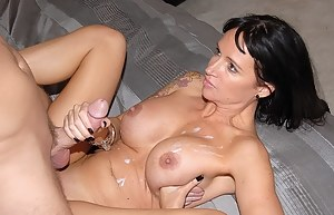 Wonderful woman having dark hair is playing filthy games with her man. She is giving him deep blowjob and riding his strong penis.