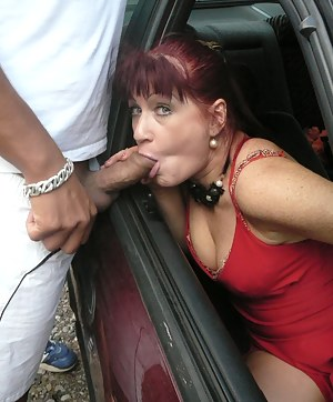 Mature slut sucking two guys from a car