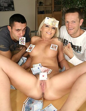 Juicy babe having big boobs is playing cards with two strong men. She is losing her game and they are punishing her extremely hard.