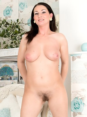 Naughty cougar with giant tits spreads open her wet hairy twat