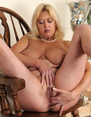 47 year old Tahnee Tayor frees her massive juggs and fingers her pussy