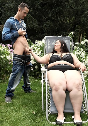Naughty brunette BBW Jitka sitting on a guy's face outdoors
