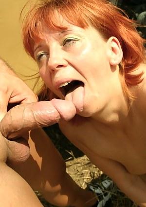 redhead eating cum outside