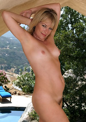 47 year old Tina from AllOver30 is naked and spreading outdoors