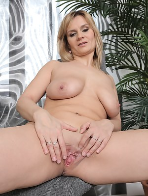 Cute 37 year old blonde Charlotta Rose showing off her large mams