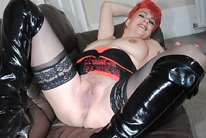Pictures of Dimonty with red hair dressed in her black and red Basque and flashing her wet pussy.