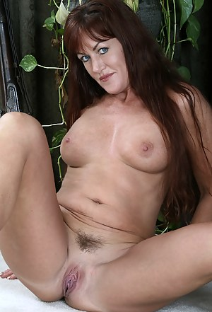 Redheaded MILF Shauna shows off her firm ass in these pictures
