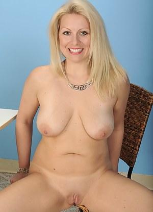 Busty mature blonde Zoey Tyler spreads ass cheeks.