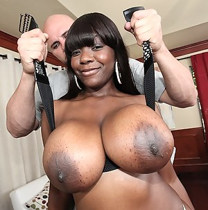 Lustful fat babe having ebony body is demonstrating sensational fuck skills with pleasure. She is taking sensual care of amazingly big white penis.