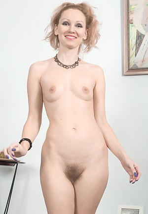 Foxy is looking very foxy while vacuuming around her house. She strips naked and shows off her hairy pussy. She lays back, touches her hairy pussy and gives herself deep pleasure from her play.