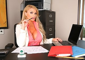 Upskirt view of the perfect big tits and tight ass of a stunning office lady before she has her shaved cunt penetrated by her boss.